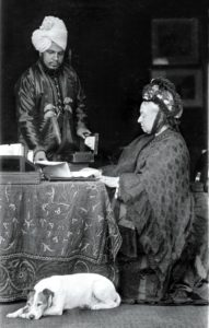 Queen Victoria at her desk, assisted by her servant Abdul Karim, the 'Munshi'. Date: c. 1885 (www.dailymail.co.uk)